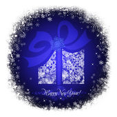 Christmas gift box on a blue background with white snowflakes — Stock Photo