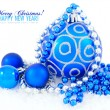 Blue and silver christmas decoration baubles on white with space — Photo