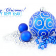 Stock Photo: Blue and silver christmas decoration baubles on white with space