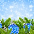 Blue and silver christmas decoration baubles and pine on festive - ストック写真