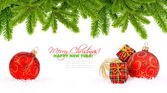 Christmas decoration baubles and pine on white with space for te — Stock Photo