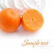Cream with tangerines on a white background — Photo