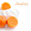 Cream with tangerines on a white background — Stock Photo