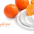 Cream with tangerines on a white background — Stock Photo #8473935