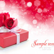Little red gift on festive background — Stock Photo