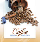 Old-fashioned coffee grinder and roasted coffee beans — Stock Photo