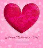 A lace decorative heart is on a pink background — Stok fotoğraf