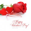 Two velvet hearts are with a red rose on a white background — Stock Photo