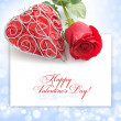 Stock Photo: Decorative heart with red rose on festive background with spac