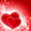 Stock Photo: Two decorative hearts are on a red festive background