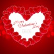 A heart is from decorative hearts on a red festive background — Stock Photo #8884263