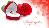 Red velvet box with golden ring and red rose on a festive backgr — Stock Photo