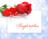 Two velvet hearts with a red rose on a festive background with s — Stok fotoğraf