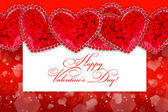 Decorative hearts on a red festive background with space for tex — Stock Photo