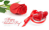 Two decorative hearts are with a red rose on a white background — Stock Photo