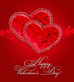 Two decorative hearts are on a red festive background — Stock Photo