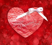 Decorative heart is on a red festive background — Stock Photo