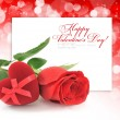 Red velvet Heart-shaped Gift Box and rose on a festive backgroun - Stock Photo