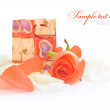 Little gift bag with rose on a white background — Photo