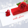 Two decorative hearts with a red rose and velvet box by a gift o — ストック写真