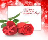 Red velvet Heart-shaped Gift Box and rose on a festive backgroun — Stock Photo