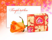 Rose in a little bag on a festive background with space for text — Stock Photo