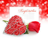 Decorative heart with red rose on a festive background with spac — Stock Photo