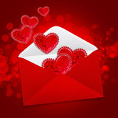 Decorative hearts are in a red postal envelope on a festive back — Zdjęcie stockowe