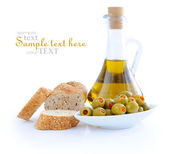 Green olives, oil, slices of bread are on a white background — Stock Photo