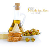 Green olives, oil, slices of bread and cheese — Stock Photo