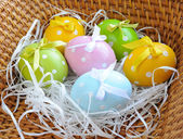 The coloured easter eggs are in a trug — Stock Photo