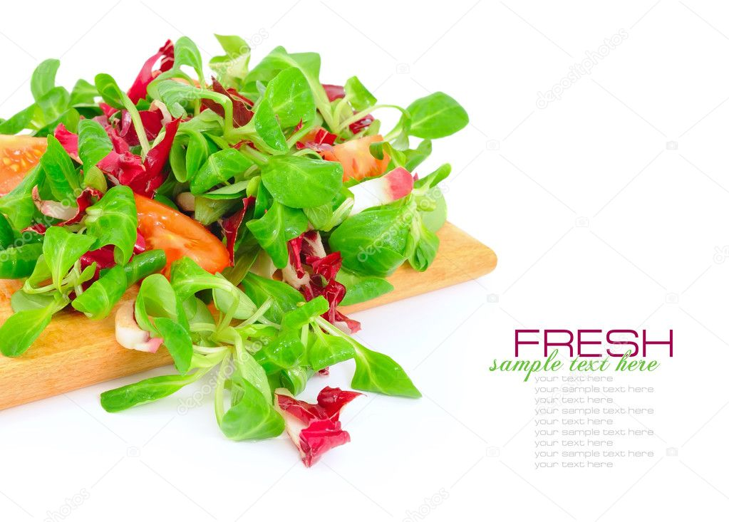 Fresh mixed salad with tomatoes on a white background — Stock Photo #9669195