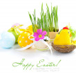 Easter eggs and green sprouts on a white background — Stock Photo #9834363