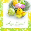 Stock Photo: Easter eggs and nest with a hen and chickens on festive background