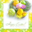 Easter eggs and nest with a hen and chickens on festive background — Stock Photo