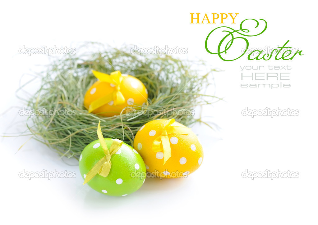 Colorful easter eggs and nest on a white background  Stock Photo #9832776