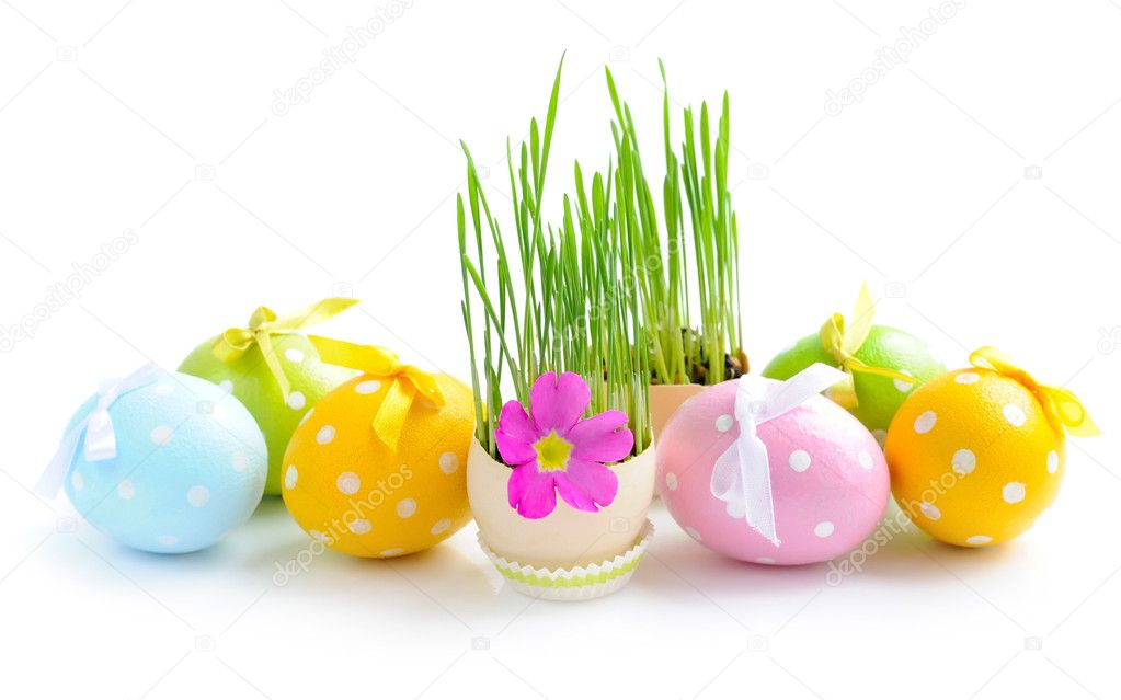 Easter eggs and green sprouts on a white background — Stock Photo #9834340