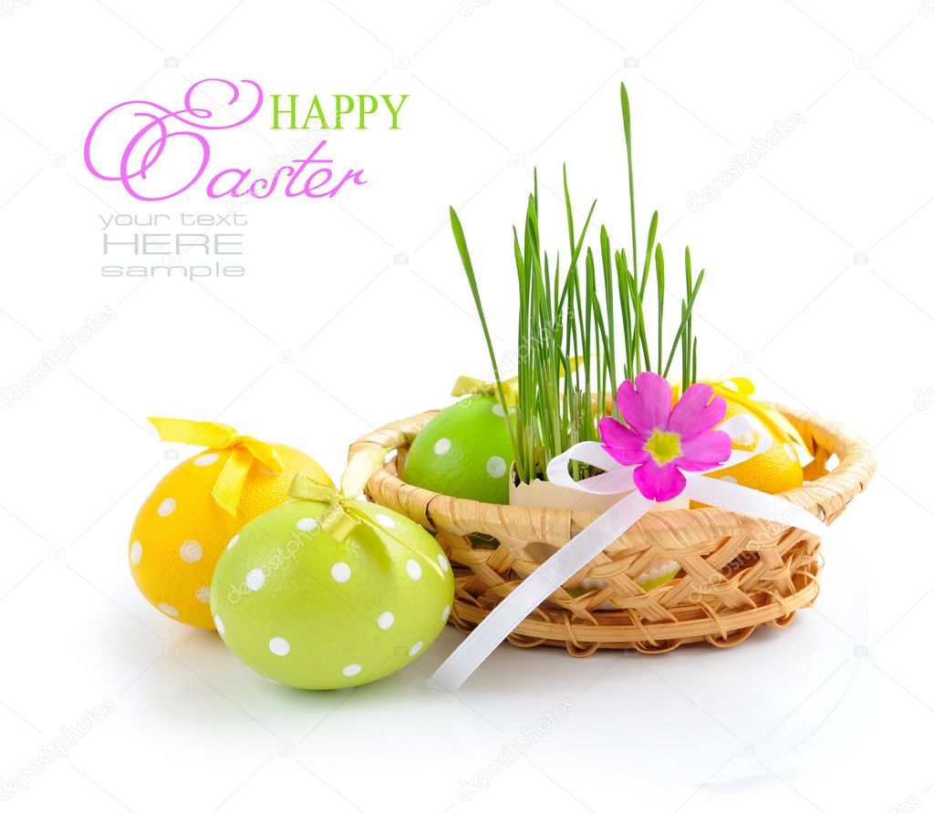 Easter eggs and green sprouts are in a basket on a white background — Stock Photo #9834404