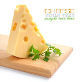 Piece of cheese on a wooden board on a white background — Stock Photo