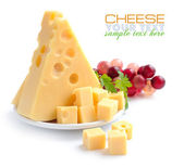 Pieces of cheese on a dish isolated on a white background — 图库照片