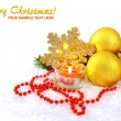 Royalty-Free Stock Photo: Christmas composition is with gold balls, candle on snow