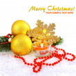 Christmas composition is with gold balls, candle on snow — Stock Photo #8150090