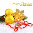 Christmas composition is with gold balls, candle on snow - Stock Photo