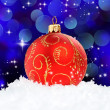 Stock Photo: Red Christmas Ball on blue backgound