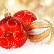Christmas balls isolated on golden background — Stock Photo