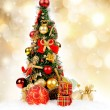 Stock Photo: Christmas tree on golden background