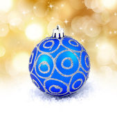 Blue christmas ball isolated on golden background — Foto de Stock