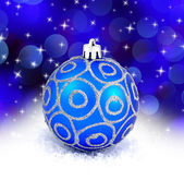 Blue christmas ball isolated on blue background — Stock Photo