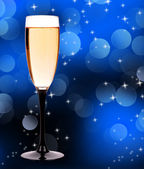 Champagne glass on blue background — Stock Photo