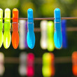 Multicolored clothes pin - Stock Photo